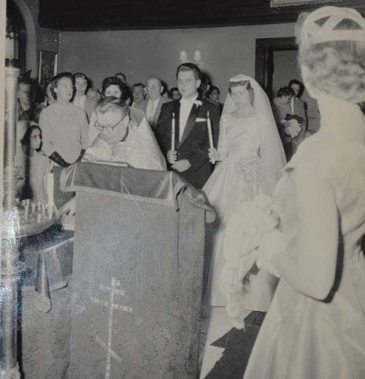 Fr. Wasilief officiates at George & Helen Bugai's wedding in a packed church on Broad St.