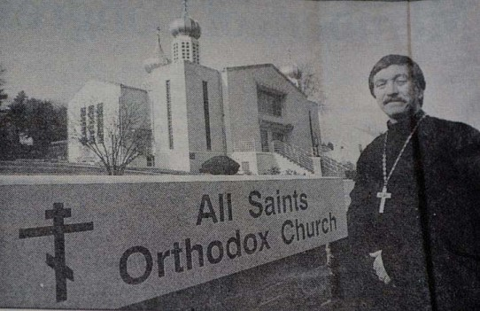 Fr. Don and the new sign